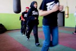Afghanistans future womens boxing team begins their workout by running laps around the inside of their gym.