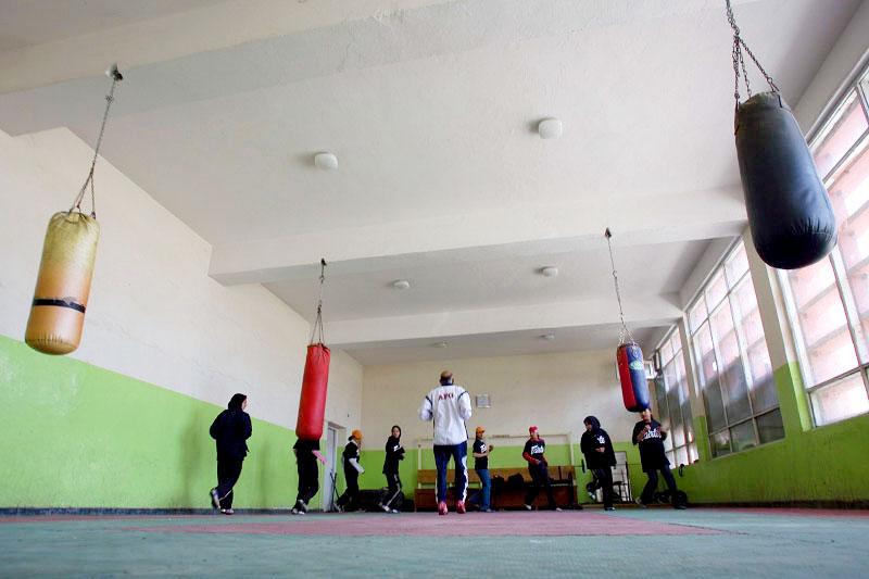 Saber Sharifi warms up his young boxers.