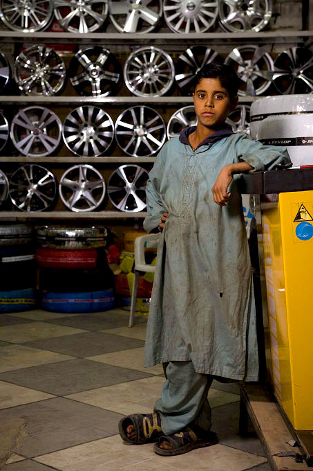 Young mechanic in a tire shop behind Super Market, Islamabad