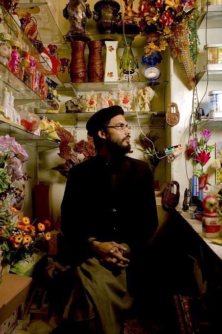 Danish Hashmi sitting in his shop stall in Aabpara Market.