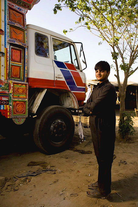 Truck drivers and the young men working with and around them. All of these portraits were taken in the truck lots surrounding the vegetable market in Rawalpindi Pakistan on March 23rd 2008.Najeeb Ulla, drivers helper,17 years old, working for 2 years.