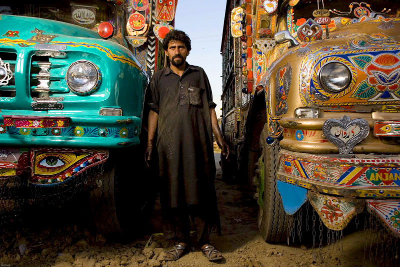 Truck drivers and the young men working with and around them. All of these portraits were taken in the truck lots surrounding the vegetable market in Rawalpindi Pakistan on March 23rd 2008.Tarique, drivers helper, 32 years old, working for 3 years.