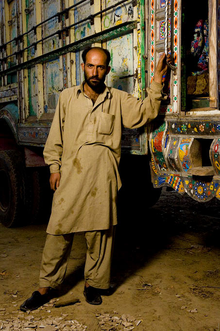 Truck drivers and the young men working with and around them. All of these portraits were taken in the truck lots surrounding the vegetable market in Rawalpindi Pakistan on March 23rd 2008.Waqar Abbassi, truck driver, 27 years old, driving for 10 years.