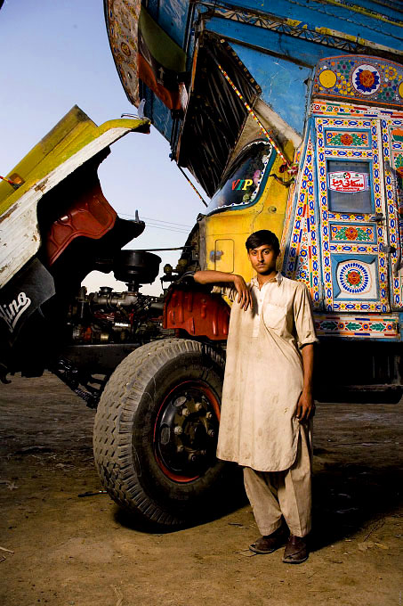 Truck drivers and the young men working with and around them. All of these portraits were taken in the truck lots surrounding the vegetable market in Rawalpindi Pakistan on March 23rd 2008.Azhar Mammuad, drivers helper ,19 years old, working for 7 years.