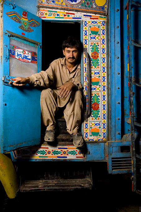 Truck drivers and the young men working with and around them. All of these portraits were taken in the truck lots surrounding the vegetable market in Rawalpindi Pakistan on March 23rd 2008.Imtiaz, truck driver, 26 years old, driving for 7 years.