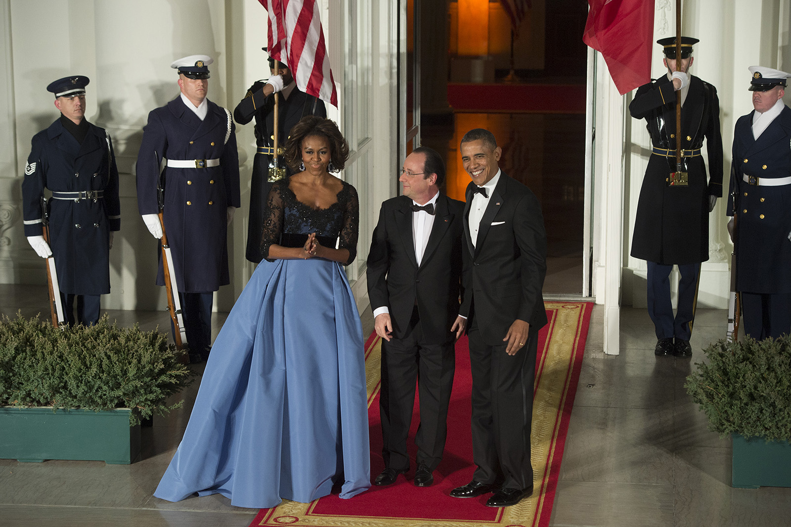 President Francois Hollande of France is greeted by First Lady Michelle Obama and President Barack Obama as he arrives at the North Portico for a State Dinner at the White House in Washington, D.C., on Tuesday, February 11, 2014.© 2014 Nikki Kahn/The Washington Post ALL RIGHTS RESERVED