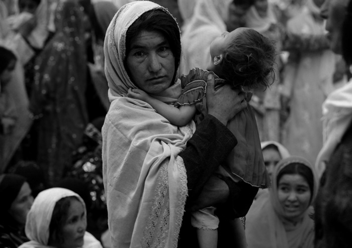 A mother holding her young child is among the group of women gathered at the invitation of religious leader Sayed Mansour Nadiri for a rally in support of  Afghanistan President Hamdi Karzai in Dar-e-Kayan, Baghlan Province.© Nikki Kahn/The Washington Post 2009ALL RIGHTS RESERVED