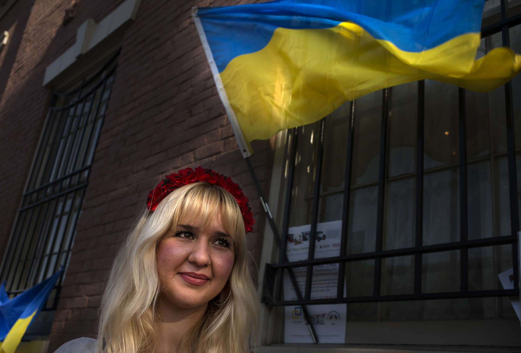 Anna Onoprienko, 26, of McLean, Virginia, with the group Razom, collects donations as local Ukrainians cast their vote for a new president at the Embassy of Ukraine in Washington, D.C., on Sunday, May 25, 2014. Washington, D.C., is one of four voting stations around the United States. New York City, Chicago and San Francisco are the other cities where Ukrainians voted for a new government. © 2014 Nikki Kahn ALL RIGHTS RESERVED