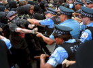 Chicago police officers scuffle with Black Bloc members as anti-war march nears 14th and Michigan Ave. May 20, 2012.  (Alex Garcia/ Chicago Tribune) B582116856Z.1 ....OUTSIDE TRIBUNE CO.- NO MAGS,  NO SALES, NO INTERNET, NO TV, NEW YORK TIMES OUT, CHICAGO OUT, NO DIGITAL MANIPULATION...