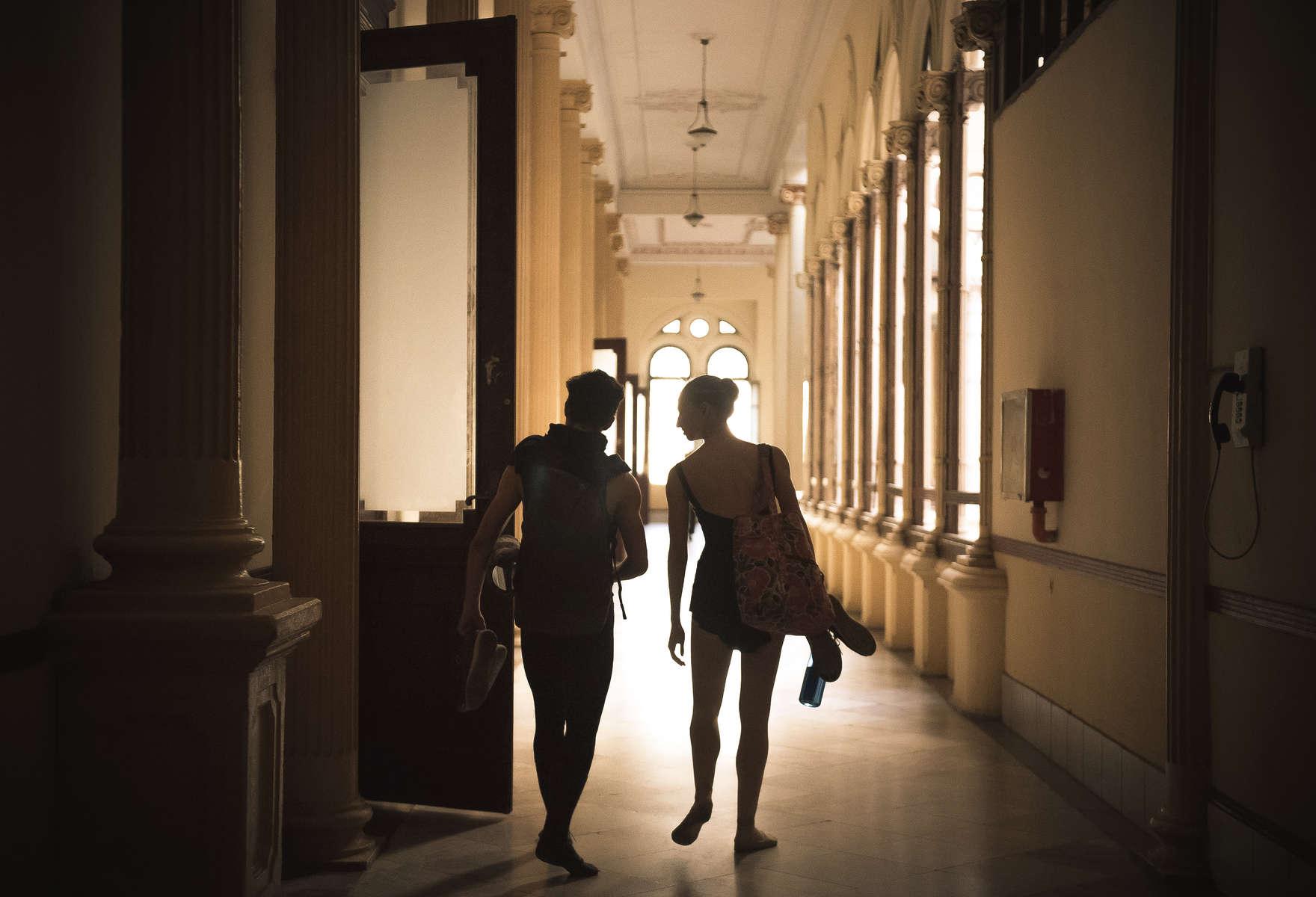 Catherine Conley walks alongside her boyfriend and fellow student Dario Hernandez Robaina in between classes at the Cuban National School of Ballet in Havana, March 10, 2017. ©2018 Alex Garcia