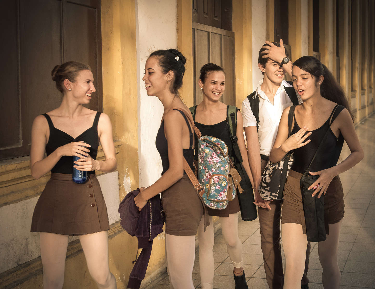 Catherine Conley shares a moment with other students after finishing a day of classes at the Cuban National School of Ballet in Havana, March 13, 2017. ©2018 Alex Garcia