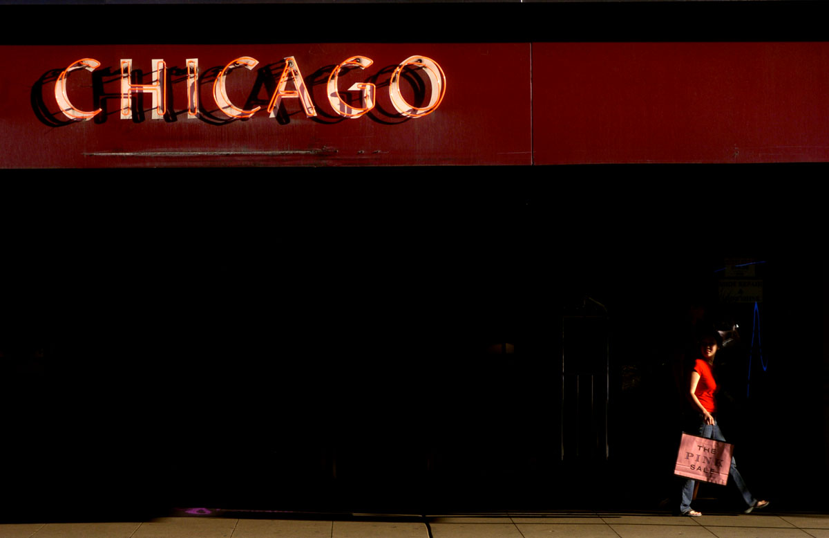 A shopper passes underneath an awning in the Loop.
