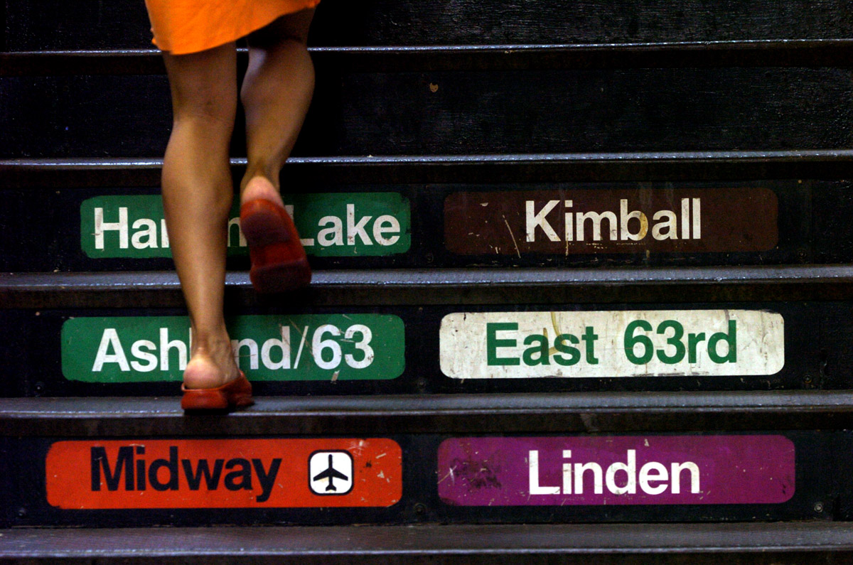 A passengers makes her way up to the trains in the Loop.