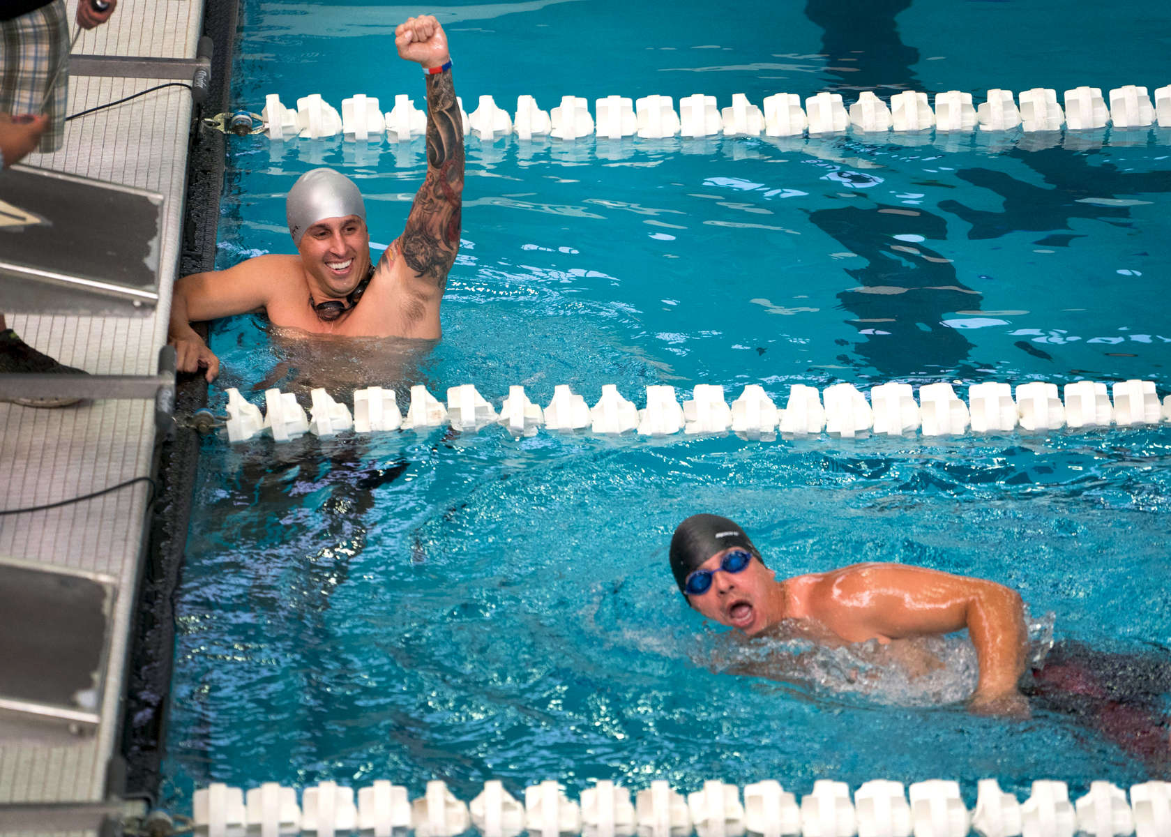 CHICAGO, IL - JULY 08, 2017:   Ramesh Haytasingh of the SOCOM team cheers on Jonathan Gonzalez of the Marine Corps during a race at the Department of Defense Warrior Games at the University of Illinois at Chicago, July 8, 2017 in Chicago, Illinois.  Gonzalez only has the use of one arm for swimming.  (Alex Garcia for ESPN)