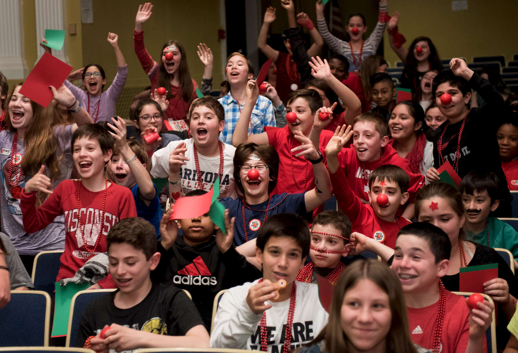 WWE Superstar Darren Young and Ambassador Dana Warrior speak to an auditorium filled with students at Elm Place Middle School in Highland Park during an event for Red Nose Day Awareness, Thursday, April 27, 2017. (Photo by Alex Garcia/AP Images for Discovery Education)
