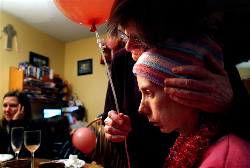During a birthday party for a family friend two weeks before Carolynne died, her mother, Kathryn Seigle, comforts her. Carolynne said she felt depressed and just wanted to get better.