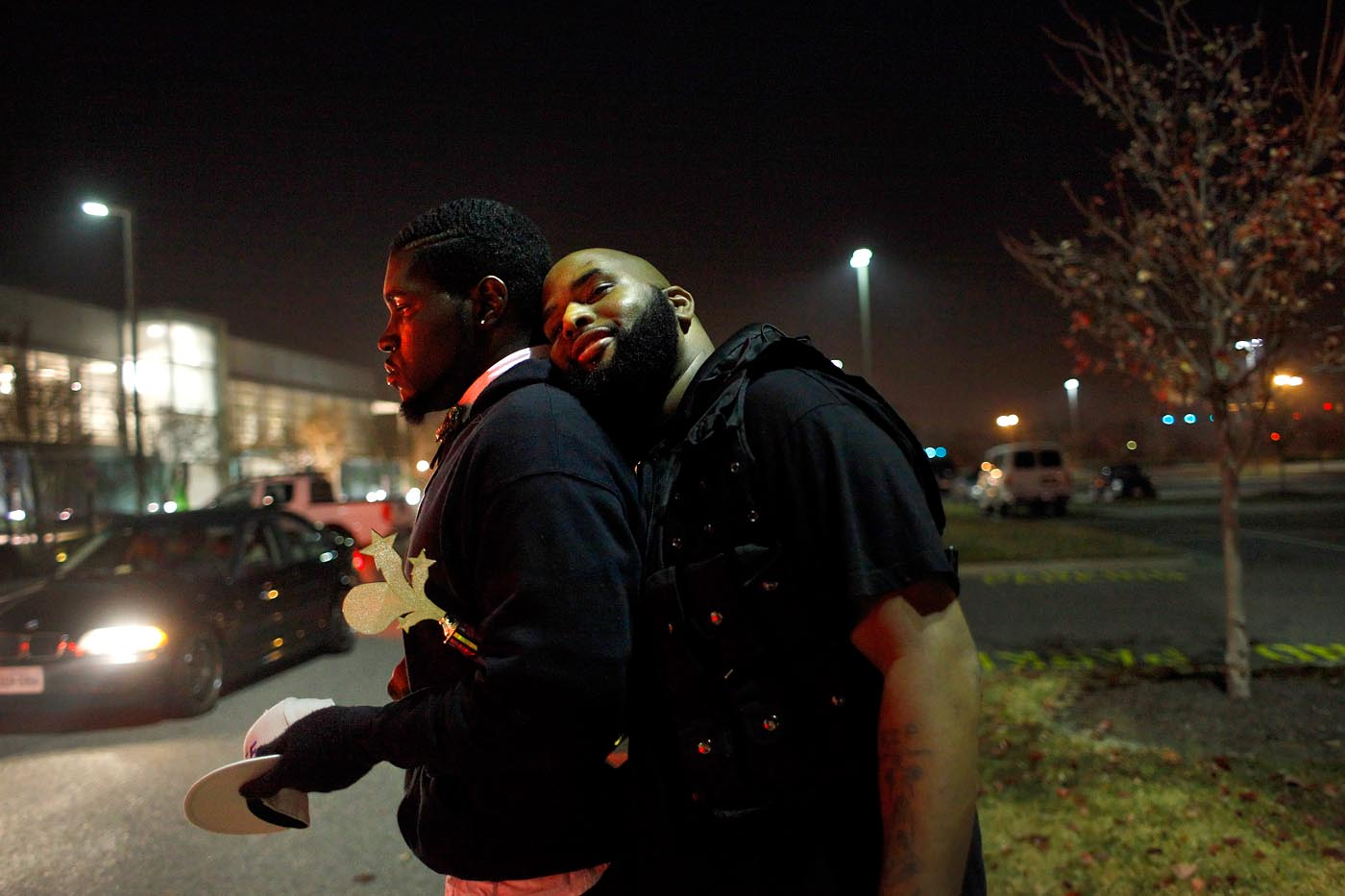 Rick Ross Ebony hugs Teddy after a ball in Hampton in December.
