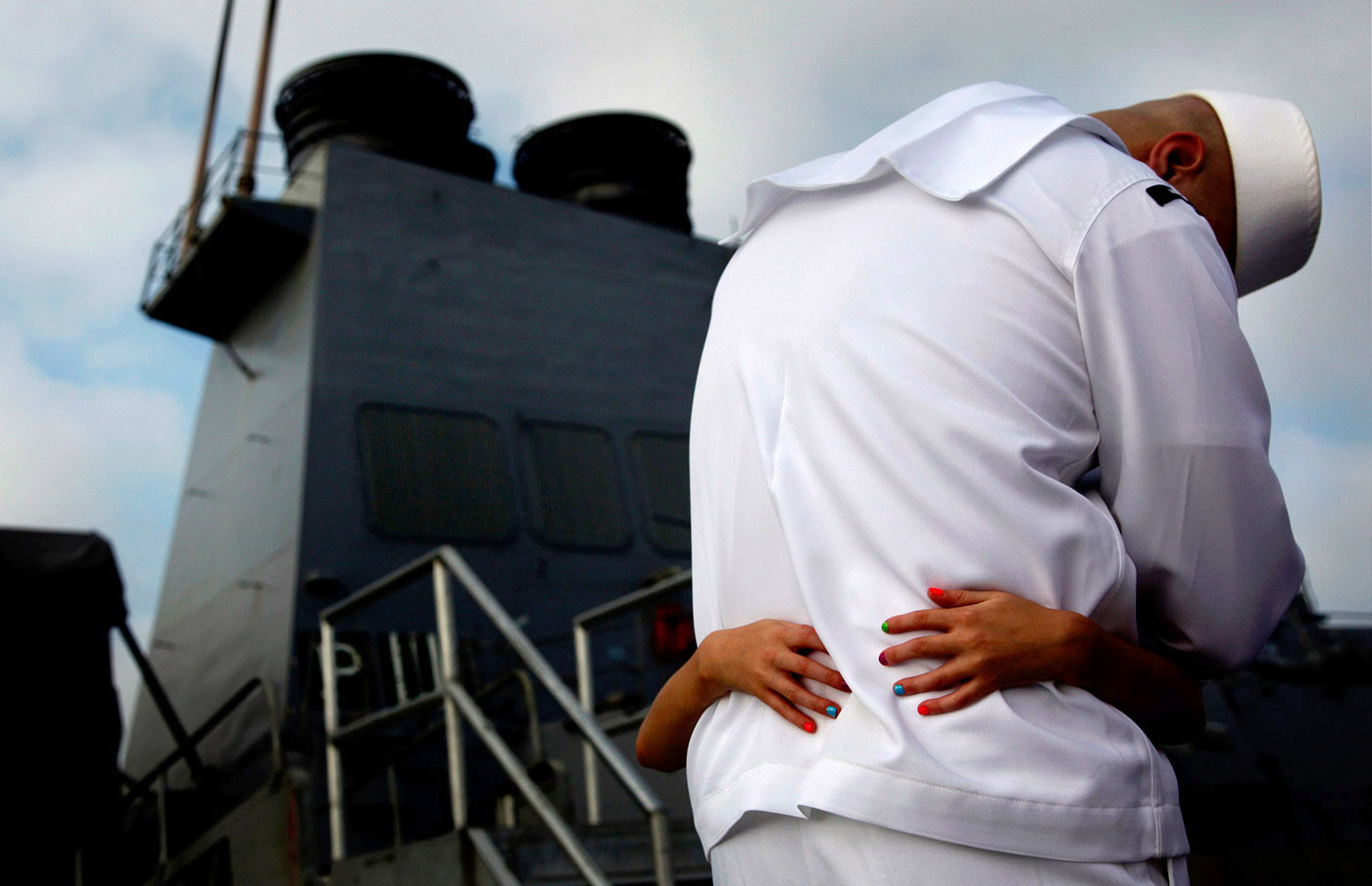 Sierra Wetterstrom, 8, clings to her father, Petty Officer 1st class Tyson Wetterstrom during his homecoming at the Norfolk Naval Station. Wetterstrom and the rest of the guided missile destroyer crew returned from a seven-month deployment to the Mediterranean Sea.