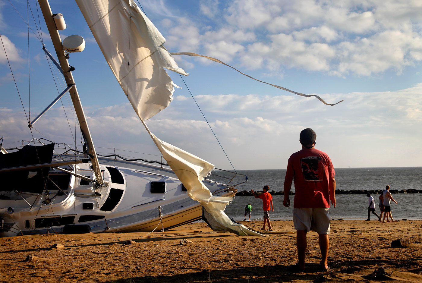 The shipwreck of Maybe Tomorrow, 2011Residents stand on the beach checking out {quote}Maybe Tomorrow,{quote} a 40-foot stranded sailboat. The boat's owners had to be rescued the day before while trying to out run Hurricane Irene's path. The sailboat became a local attraction in the days after the storm and was later destroyed by a fire before it was eventually hauled away.