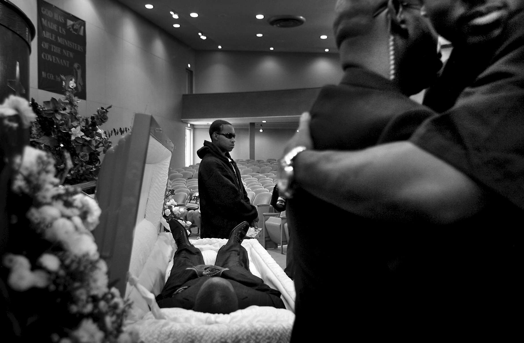 Former and current gang members and friends and family gather at New Covenant Christian Church for the funeral of Michael {quote}Sike{quote} Asberry in East Denver, Colo., on Saturday, May 24, 2008. Asberry was one of the founders of the Denver Crips.