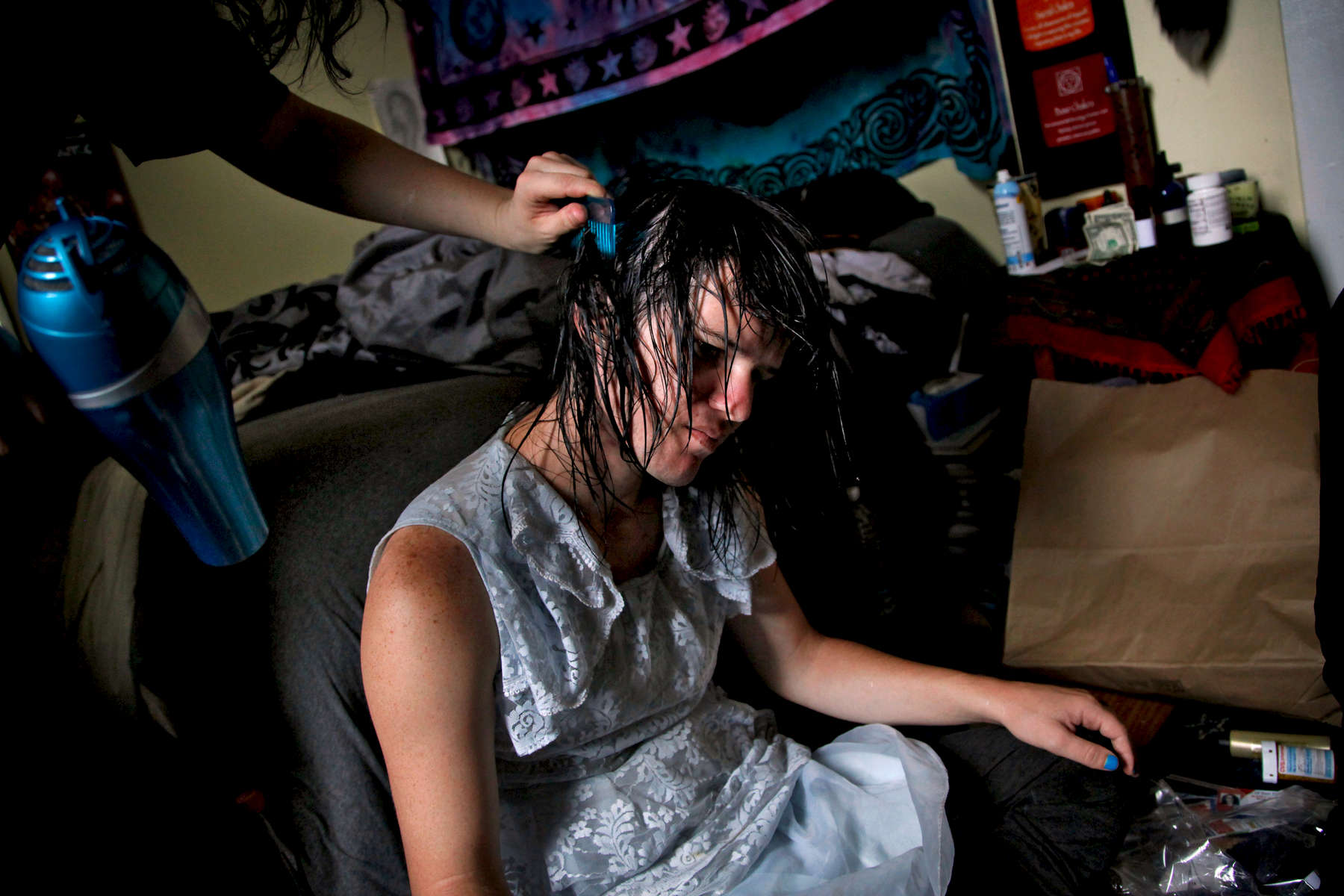 Isabella's friend Aurya Micha does her hair before her wedding in October 2015. They both have SROs in the Castro District which are supported by Larkin Street Youth Services.