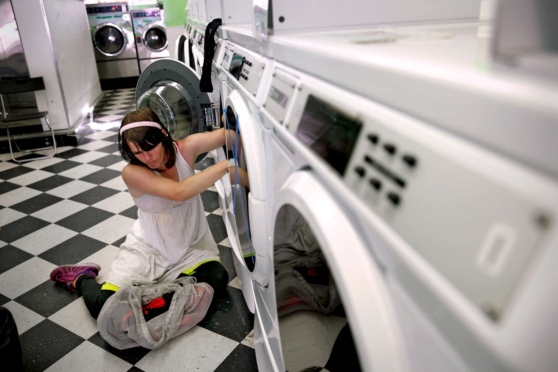 Isabella Morales-Black, 23, at a laundromat in San Francisco in October 2015. Isabella is part of a homeless street soccer team and makes a little money doing the team's laundry.