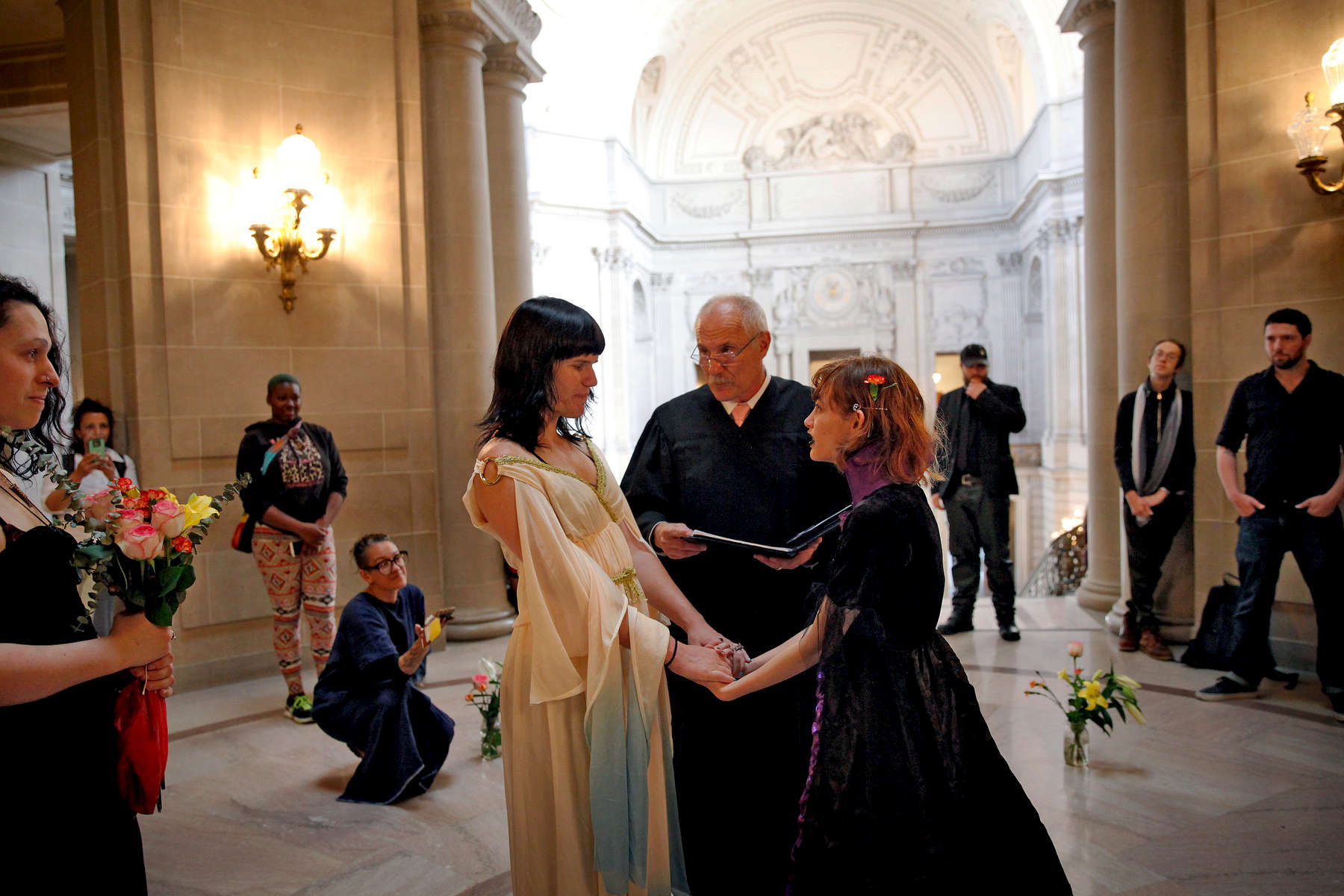 Isabella and Angel Morales get married surrounded by friends at City Hall in San Francisco, Calif., on Wednesday, October 28, 2015. {quote}All her walls came down for a moment and so did mine, to build around each other,{quote} Isabella said of the experience. {quote}I realized, at that moment, that I was completed. And it takes a lot for people who are broken and who have been hurt by the wrong people before to feel completed.{quote}(Photo by Preston Gannaway © 2015)