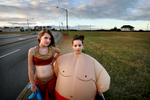 The genie and the sumo wrestler, 2009Stepsisters Kaitlyn Blaney (left) and Sonya Self, both 10, pose for a portrait while taking a walk to McDonald's before trick-or-treating on Halloween.