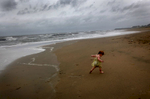 Hurricane baby, 2010Undeterred by the wind and the waves, Cailyn Ayers, 1 1/2, runs along the beach as Hurricane Earl passes through the area. Ocean View is {quote}not for the faint of heart,{quote} said one resident.