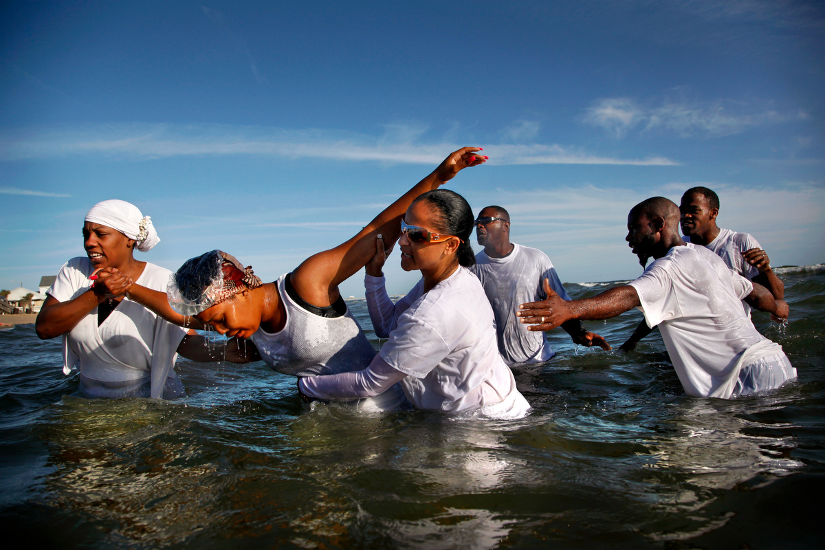 Baptism, 2013Nicole Stanley is baptized by fellow members of the Ambassadors For Christ church in the water of the Chesapeake Bay in Ocean View.
