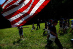 Union soldiers march across the field during one of the Civil War Children's Camp historical battles. Campers are allowed to choose between the Union or Confederate side when they sign up.