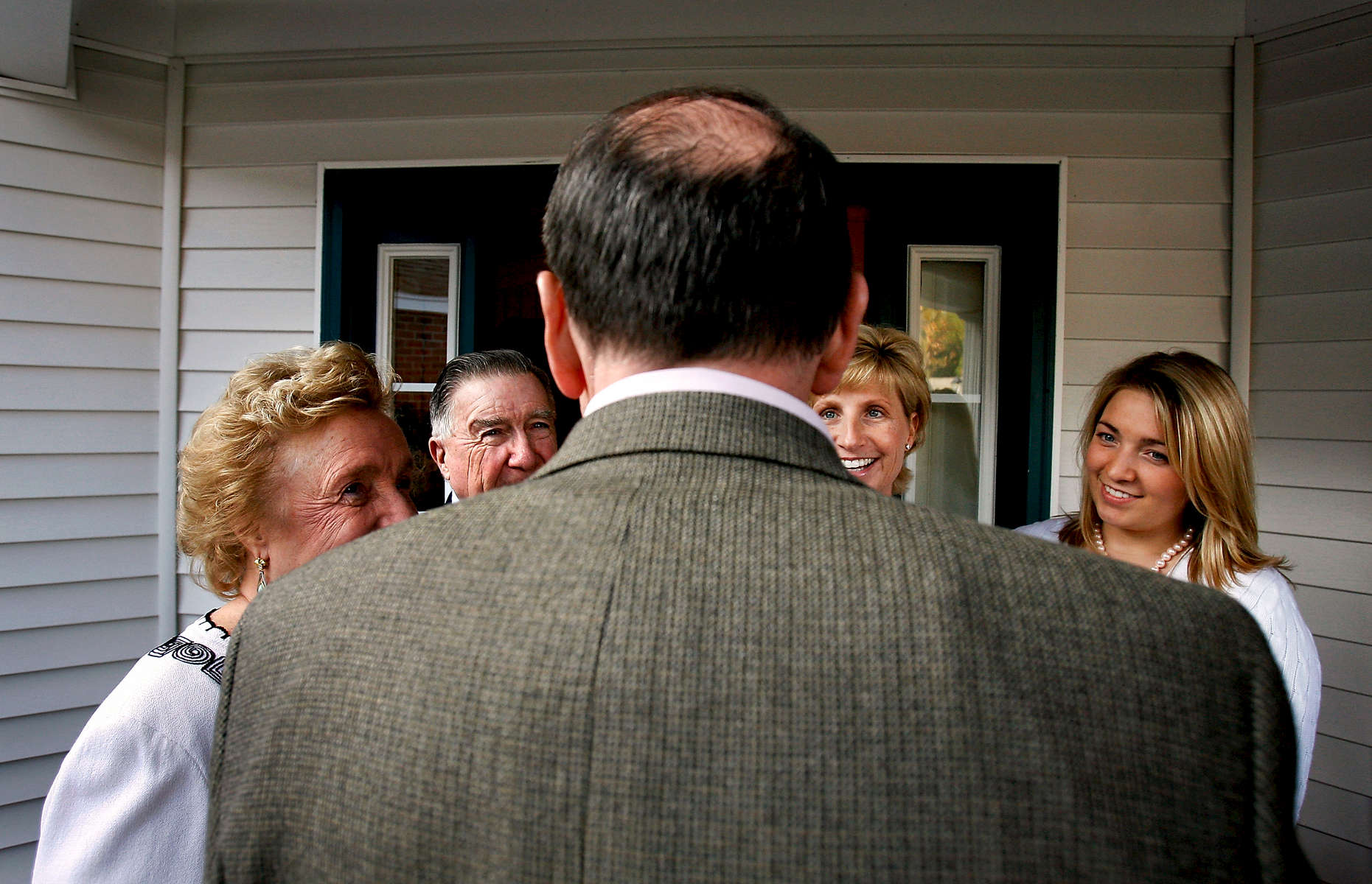 Before a house party in Bedford, Huckabee talks with hosts Estella and Bob Hughes, their daughter, Pamela Patenaude, and granddaughter Caitlin Patenaude. Presidential candidate Governor Mike Huckabee campaigns in New Hampshire on November 10, 2007.