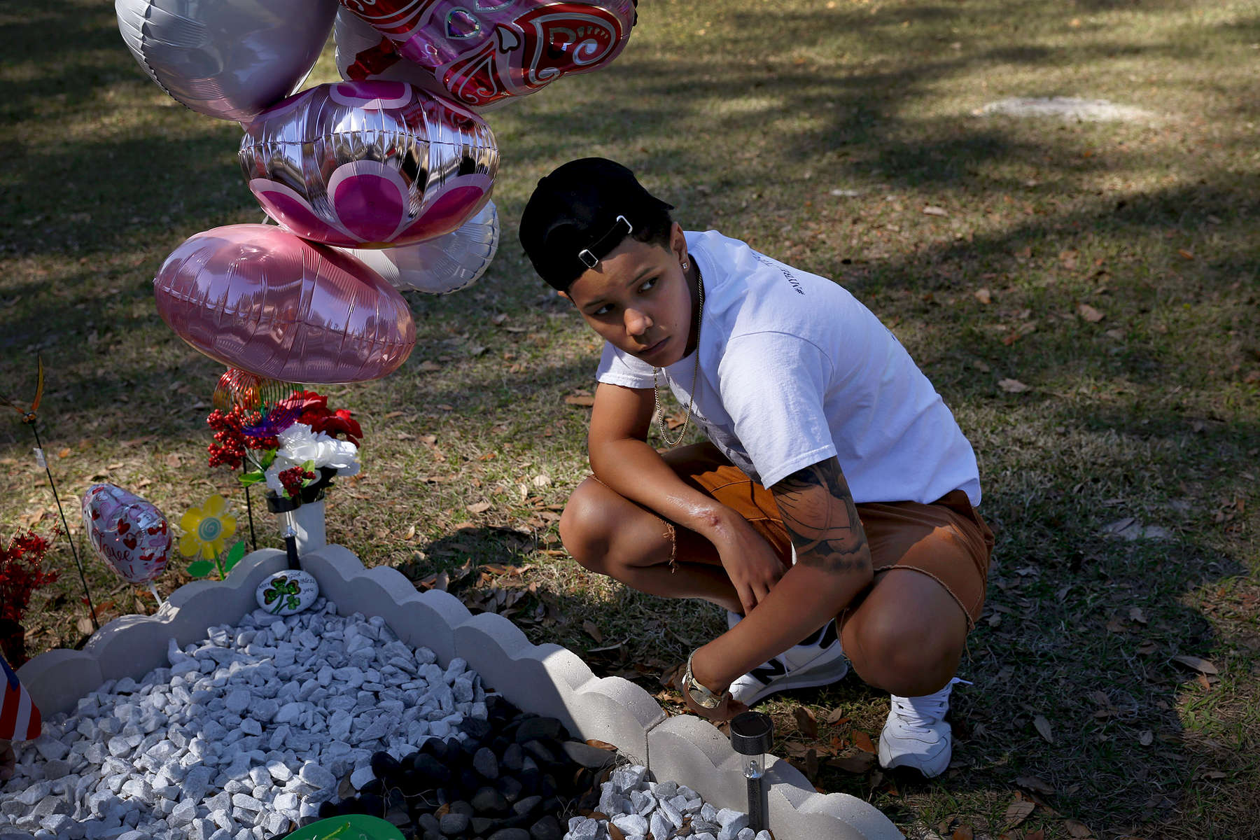 Kaliesha Andino, 19, visits the grave of her friend Omar eight months after the Pulse shooting in Orlando, Fla., on Sunday, February 12, 2017. Luis Omar Ocasio-Capo was 20 when he was killed during the shooting. They had been friends since middle school.(Photo by Preston Gannaway © 2017)
