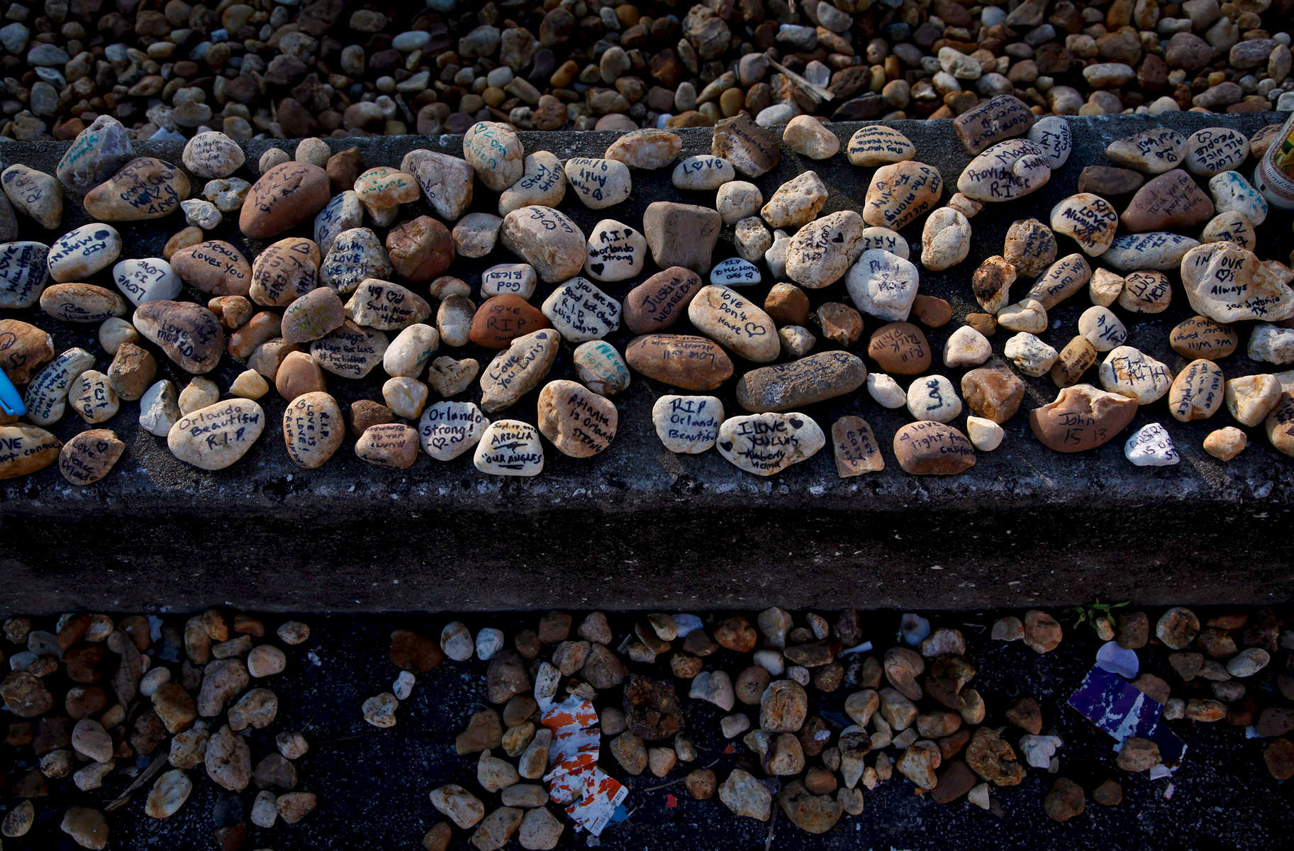 Landscaping pebbles outside the closed Pulse are turned into tiny memorials.