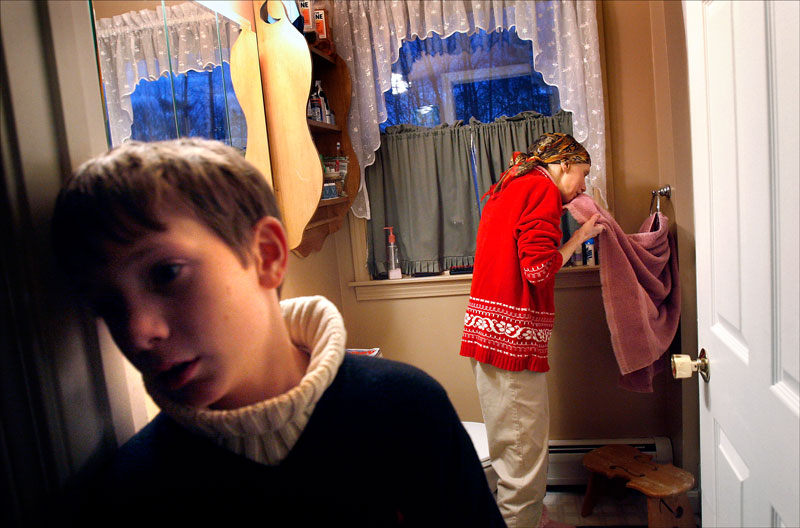 Brian stands outside the bathroom while his mother cleans up after a bout of nausea. {quote}I just see so much wear and tear on the family unit,{quote} said Carolynne's sister Sara Matters.