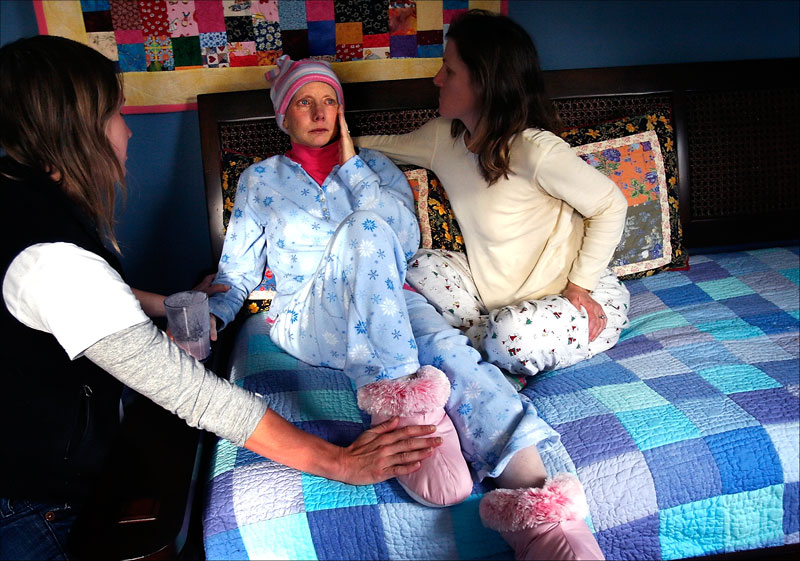 Carolynne St. Pierre pauses to compose herself while recording a video for her children. Her sister Sara Matters and cousin Anna Stoessinger comfort her. Doctors had just told Carolynne she would only survive for a number of weeks or months.