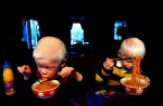 Paul (left) and Micah (right) eat noodles for breakfast shortly after Micah was adopted. While Paul and Elijah still prefer an Asian-influenced diet, they have lost most of their Chinese customs and language since moving to the United States.