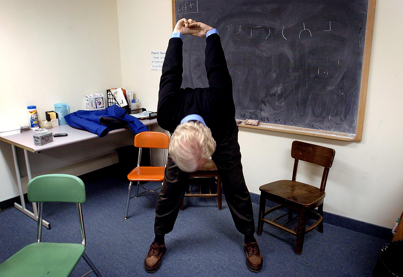 Senator Joe Lieberman stretches in a classroom at Temple Beth Jacob in Concord before a presidential forum. He also did push-ups and jumping-jacks as part of his pre-debate workout routine. January 2004