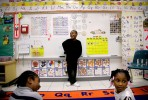 Quinndarius Brandon laughs while during an excercise on life cycles in Brandon Thompson's kindergarten class at Diamond Springs Elementary School in Virginia Beach, Va., on Wednesday, May 6, 2009. Male kindergarten teachers are increasingly rare. In the foreground are students Dontrae Kelly (left) and Myona Hayden (right).(Preston Gannaway/The Virginian-Pilot)