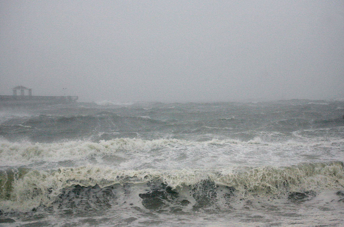 Waves from Hurricane Irene crash on the Ocean View Fishing Pier in Norfolk, Va., on Saturday, August 27, 2011.