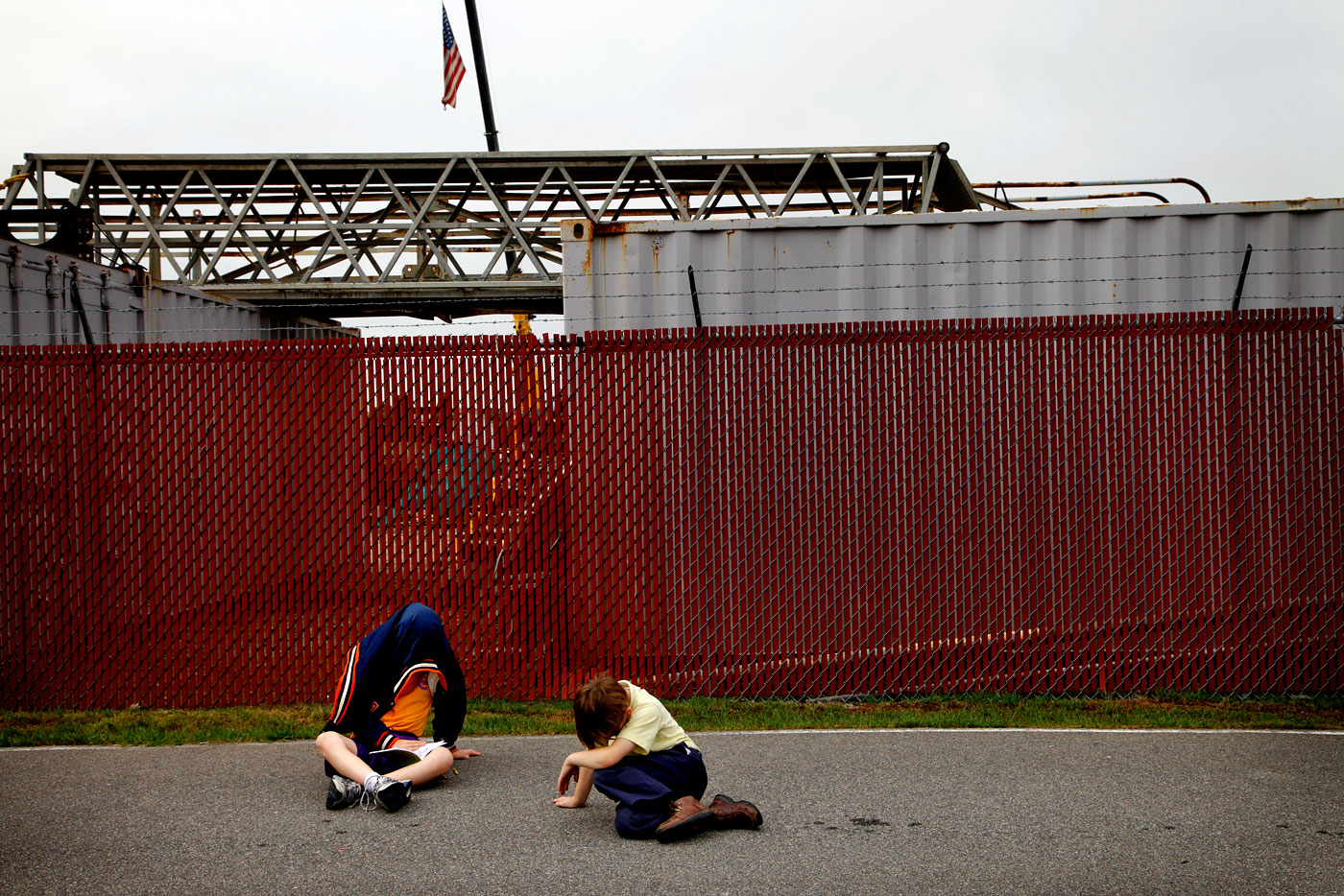 Louie D'Angelo, 11, and his brother Andy, 8, wait for the gates to open for a Mitt Romney campaign event in Portsmouth, Va., on Thursday, May 3, 2012. {quote}We pulled them out of school cause this is history,{quote} their mother said.