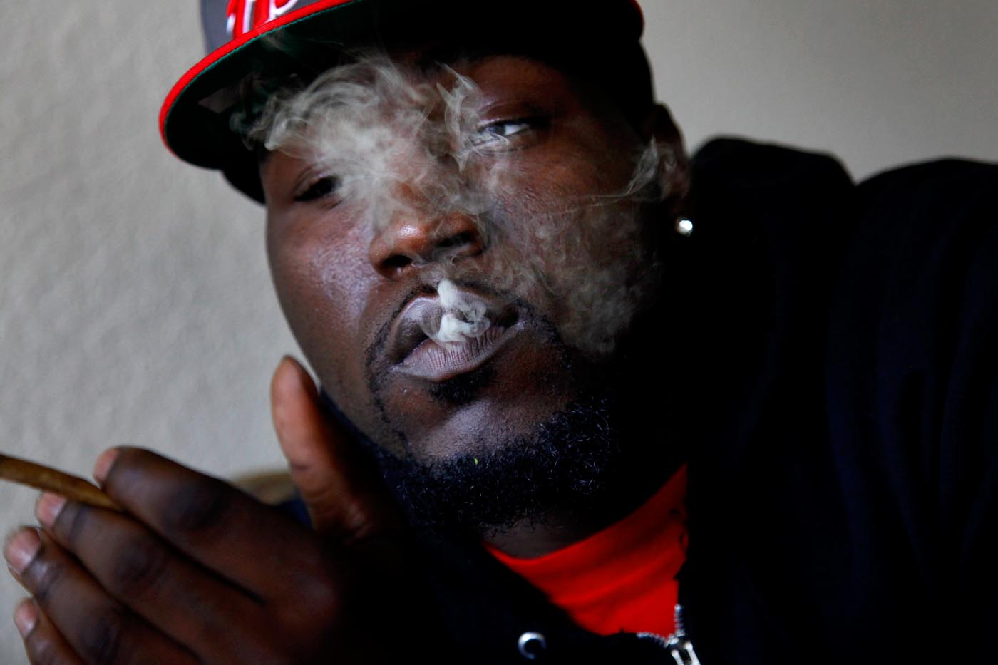 Teddy smokes weed while hanging out with a friend in Norfolk, Va. He once wrote on Facebook: {quote}I smoke to keep myself from crying.{quote}
