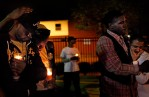 At a candlelight vigil he organized for a friend who died, Teddy, third from left, comforts Anthony Winters. Punch Ebony, who died of cancer, was part of Teddy's ballroom family. The vigil was held in part because Punch's gay friends were afraid they wouldn't be welcome at the funeral.