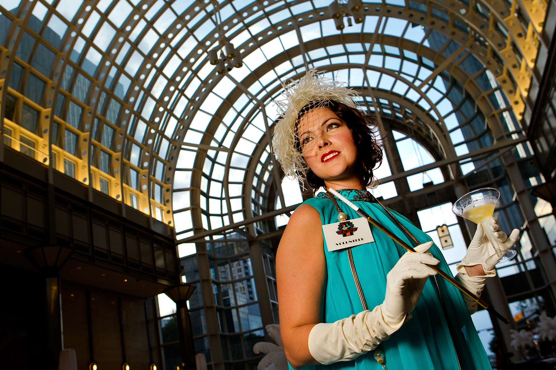 Event photography of the 24th Annual Great Gatsby Gala, presented by Wells Fargo and held at the Wells Fargo Atrium in Uptown Charlotte NC. Guests raise funds for MS while also reliving the days of the {quote}Roaring 20s{quote} and enjoying beverages and food from local Charlotte restaurants showcasing their culinary specialities.Photo by Charlotte Photographer - PatrickSchneiderPhoto.com