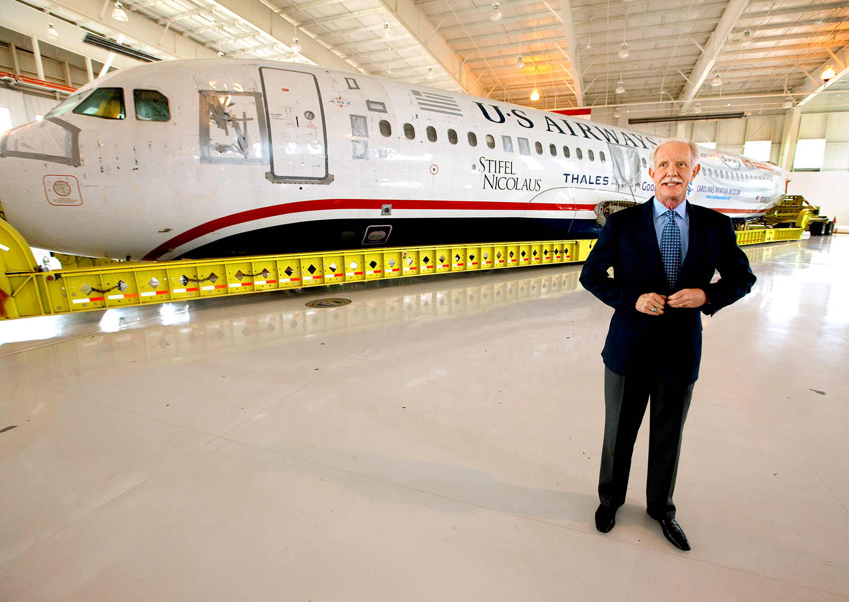 Captain Chesley {quote}Sully{quote} Sullenberger was in Charlotte NC to greet the arrival of US Airways Flight 1549, also known as the Miracle on the Hudson plane, at the Carolina Aviation Museum in Charlotte, NC.  Two years earlier, the commercial passenger flight was enroute to Charlotte/Douglas International Airport when it was successfully landed in New York's Hudson River after striking a flock of Canada Geese six minutes after taking off from LaGuardia Airport.