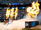 Carolina Panther's Quarterback Cam Newton is illuminated in a fiery introduction prior to the start of their preseason NFL game v. the Miami Dolphins at Bank of America Stadium in Charlotte, North Carolina.Charlotte Photographer: PatrickSchneiderPhoto.com