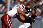 Arizona Cardinals linebacker Rob Fredrickson hits Chicago Bears running back James Allen causing him to fumble at Soldier Field