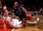 Duke Blue Devils Jason Williams tries to control the ball after colliding with Maryland Terrapins Steve Blake at Cole Field House