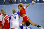 A handball match between Hungary and Greece with intense action