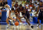 USA guard Dywane Wade battles for a loose ball wih Argentina guard Manu Ginobili during the semi-final game of the 2004 Athens Olympics